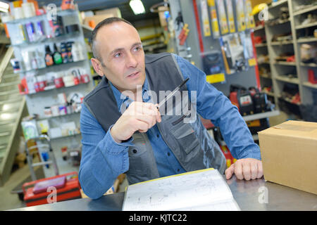 portrait of hardware store worker - Stock Photo