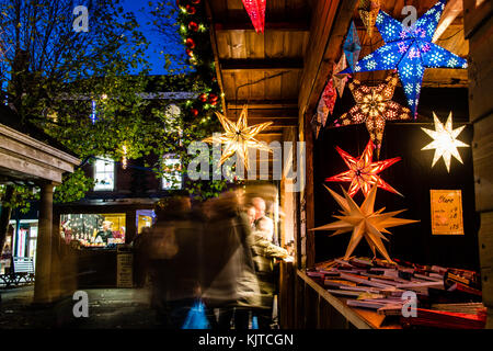 A Christmas Market Stall in York, selling star shaped decorations. - Stock Photo