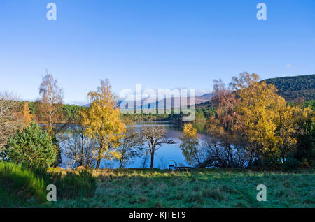 View across Loch an Eilein to the Cairngorm mountains beyond, Rothiemurchus, Scottish Highlands, sunny autumn day, - Stock Photo