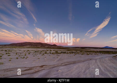 Photo taken in August 2017 in Altiplano Bolivia, South America: Sunrise Sunset Mountains View over Altiplano Desert - Stock Photo