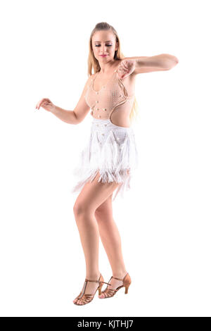 Female Latino skillful dancer moving arms smiling and looking down. Full body length portrait isolated on white - Stock Photo
