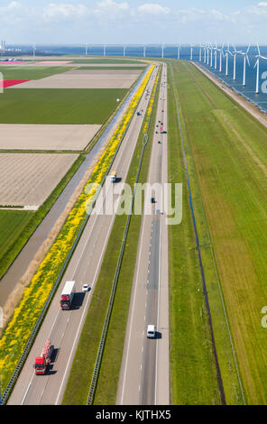 Aerial view of road and wind turbines, North Holland, Netherlands - Stock Photo
