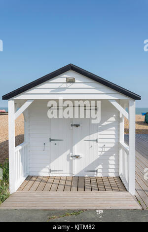Wooden beach hut by The Deal Memorial Bandstand, The Strand, Walmer, Deal, Kent, England, United Kingdom - Stock Photo