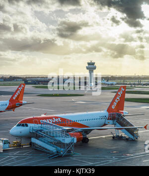 London Gatwick, UK - Nov 23rd, 2017:  Easyjet airplanes at London's Gatwick airport - SouthTerminal - Stock Photo