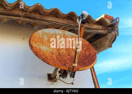 Old satellite dish - Stock Photo