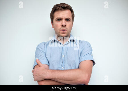 Confused caucasian man. Negative emotion - Stock Photo