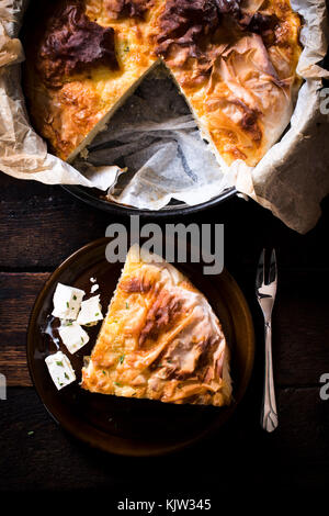 Traditional Serbian dish called burek,pie with cheese,from above - Stock Photo