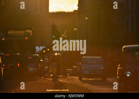 Piccadilly, London, UK.  25th November 2017. Sunset on Piccadilly in central London. Credit: Matthew Chattle/Alamy - Stock Photo