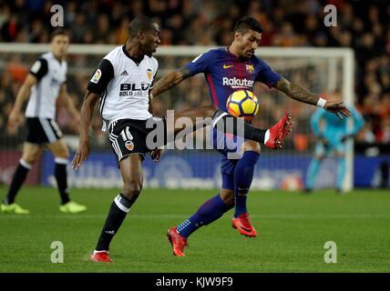 Barcelona, Spain. 26th Nov, 2017. FC Barcelona's Paulinho vies for the ball with Valencia's Geoffrey Kondogbia (L) - Stock Photo