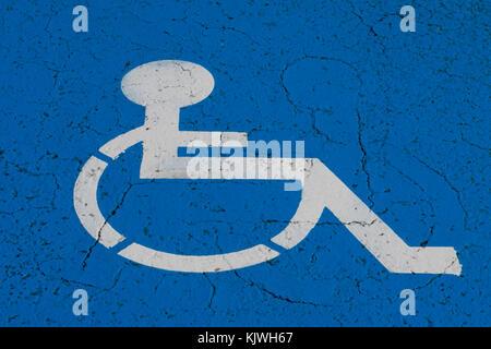 wheelchair symbol on handicap parking spot - - Stock Photo