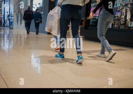 People walking through mall with shopping bags. Personas en centro comercial, bolsas de compras. photo by: Roberto - Stock Photo