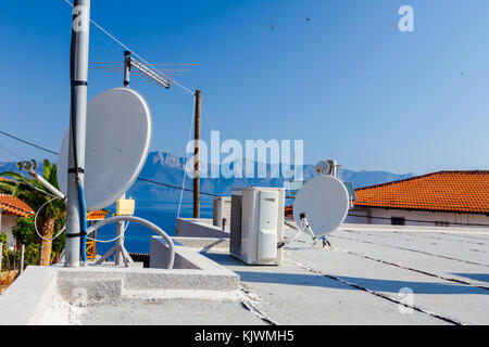House roof with few different typs of antennas and external conditioner unit. - Stock Photo