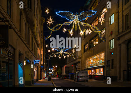 LONDON - NOVEMBER 25, 2017: Christmas lights on Jermyn Street. Beautiful Christmas decorations attract thousands - Stock Photo