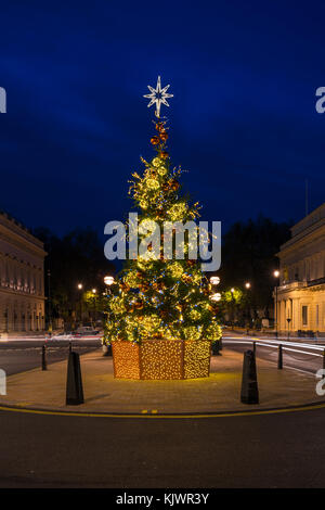 Beautifully decorated Christmas tree on Waterloo Place in London, England - Stock Photo