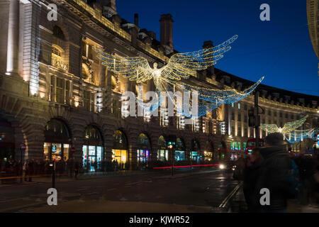 LONDON - NOVEMBER 25, 2017: Christmas lights on Regent Street, London, UK. The Christmas lights attract thousands - Stock Photo