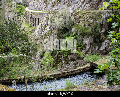 Hydroelectric feeder canal and service path winding through the deep karst limestone chasm of the Cares Gorge in - Stock Photo