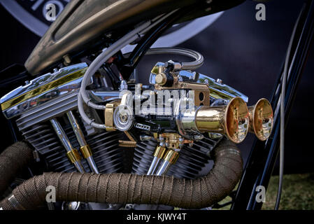 Ram pipes and Carburettor detail of a custom Harley Davidson chopper Motorcycle closeup. - Stock Photo