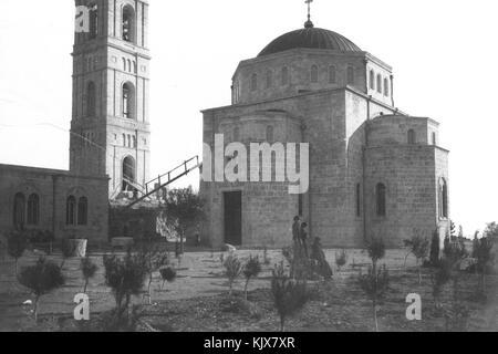 THE ELEONA CHURCH UNDER CONSTRUCTION ON THE MOUNT OF OLIVES IN JERUSALEM C. 1890 - Stock Photo