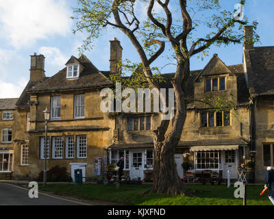 Independent shops in attractive historic High Street of small market town Chipping Camden Cotswolds Gloucestershire - Stock Photo