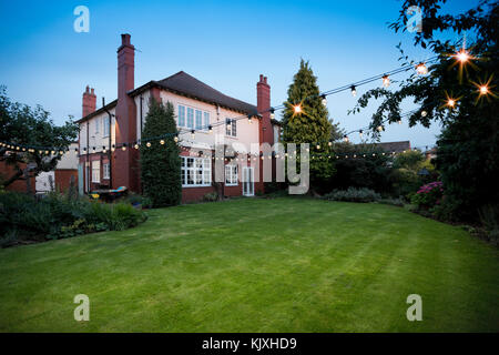 House and garden in summer 2017 - Stock Photo