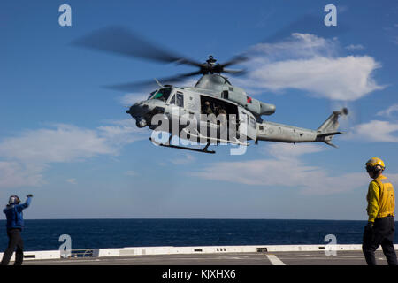 U.S. Marines with the Maritime Raid Force (MRF), 26th Marine Expeditionary Unit (MEU) depart for a simulated visit, - Stock Photo
