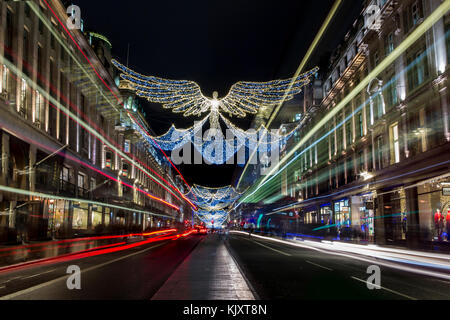 Christmas Lights and Decorations in Regent Street - Stock Photo