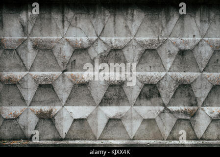 Concrete fence, old wall covered with mud from the rain, autumn background. Raw concrete with a pattern. - Stock Photo