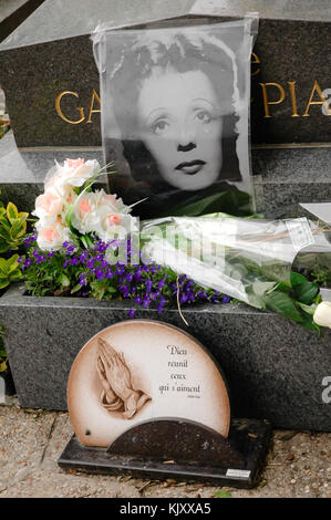 Picture on a tomb of Édith Piaf a French cabaret singer, songwriter, and actress at the Père Lachaise Cemetery, - Stock Photo