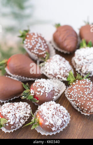confectionary, food, cooking concept. close up of delicious dessert that is presented by strawberries that are covered - Stock Photo