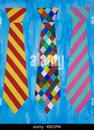 Colourful hand painted neck ties on blue wood panel background - Stock Photo