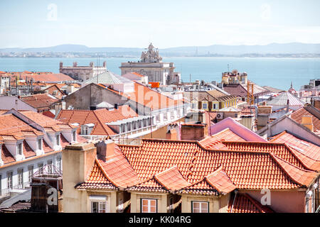 Cityscape view on the old town with Augusta arch in Lisbon city, Portugal - Stock Photo