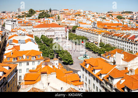 Cityscape view on the old town with Rossio square during the sunny day in Lisbon city, Portugal - Stock Photo