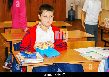 Schoolboy in class at a Desk - Stock Photo