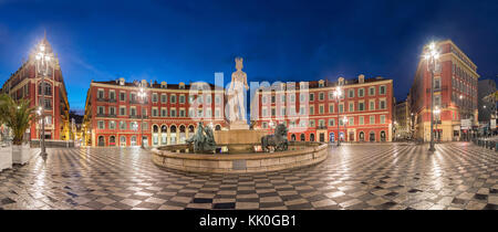 Fontaine du Soleil on Place Massena square at dusk in Nice, Alpes-Maritimes, France - Stock Photo