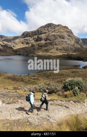 Ecuador Travel - a couple walking in El Cajas National Park, southern Ecuador, South America - Stock Photo