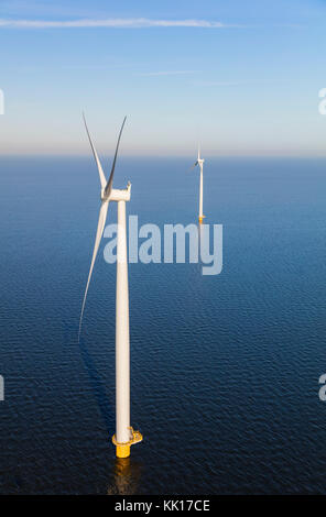 Aerial view of wind turbines at sea, North Holland, Netherlands - Stock Photo