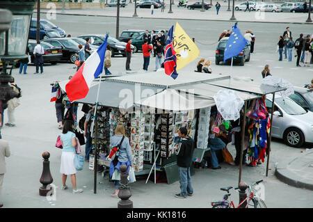 Market stall on a historic Place de la Concorde in Paris selling souvenirs and postcards - Stock Photo