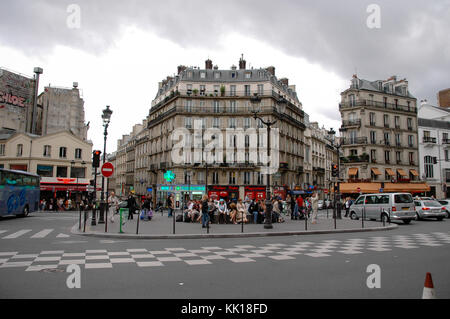 Plaza Place Blanche in Paris is a popular tourists destination famous for a location of the cabaret Moulin Rouge - Stock Photo