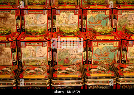 Open air market stall in Paris with different variety of loose tea in packed in the cans - Stock Photo