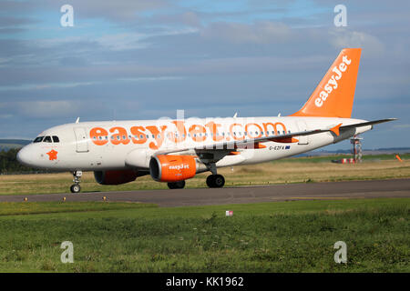 An Easyjet Airbus A319 arrives at Inverness Airport on the daily commute from London - Stock Photo