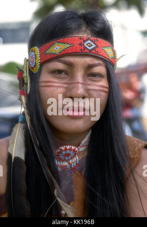 Woman dressed as Native American Indian.  Thailand, Southeast Asia - Stock Photo