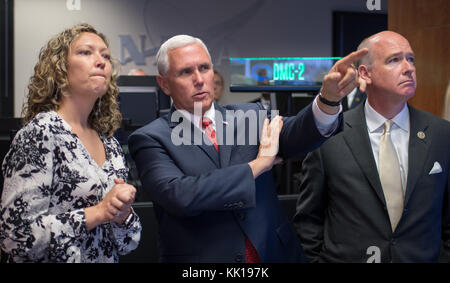 NASA Payload Operations Director Stephanie Dudley (left) gives U.S. Vice President Mike Pence and U.S. Alabama Representative - Stock Photo