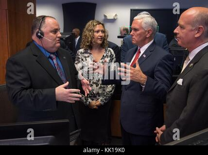 NASA Payload Operations Directors Steven Dyer (left) and Stephanie Dudley give U.S. Vice President Mike Pence and - Stock Photo