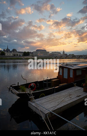 Traditional wooden boats moored on the Loire in the historic town of Saumur in the Loire Valley in France. - Stock Photo
