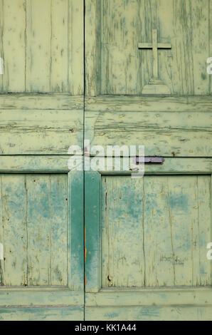weathered green painted doorway on old chapel, florence, italy - Stock Photo