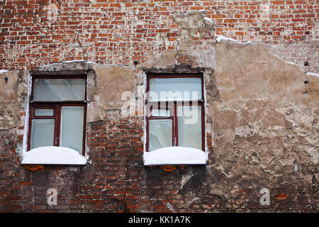 Red brick wall with a row of roof tiles on top stock photo for Best windows for cold climates