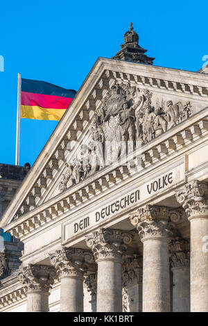Berlin Parliament Building, view of detail of the pediment and inscription on the grand portico of the Reichstag - Stock Photo