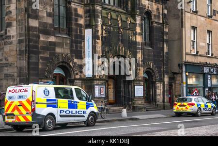 Police van and police car parked on George IV Bridge, outside St Augustine United Church, Edinburgh, Scotland, UK - Stock Photo