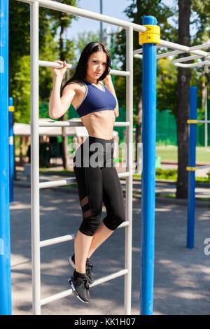 female on sport playground - Stock Photo