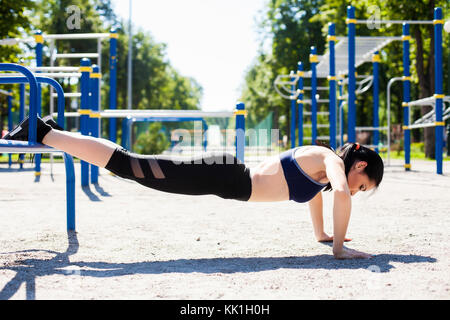 young sportive girl on sport playground - Stock Photo